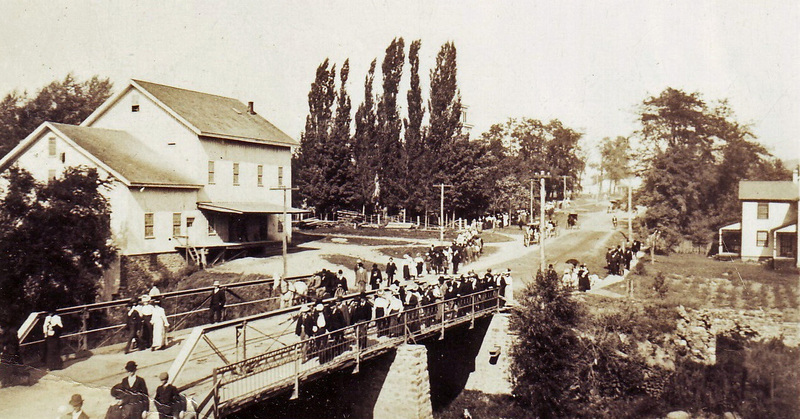 Crowds walking to the Hemlock Fair, ca. 1900